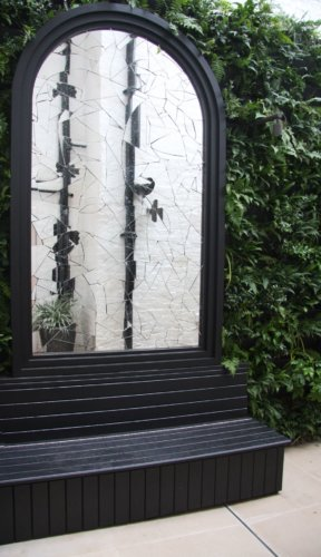 Shatter glass mirror in garden editeed